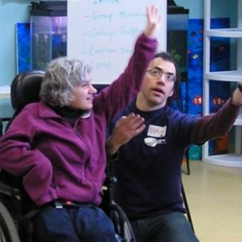 Dylan Fresco works with Krista at an Upstream Arts workshop where professional artists from across the metro use arts education to enhance the lives of youth and adults with disabilities. Photo courtesy of Matt Guidry of Upstream Arts.