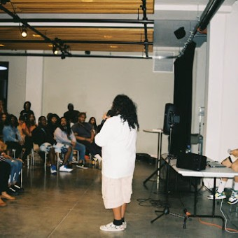 An audience at Tangible Thoughts watches a performer