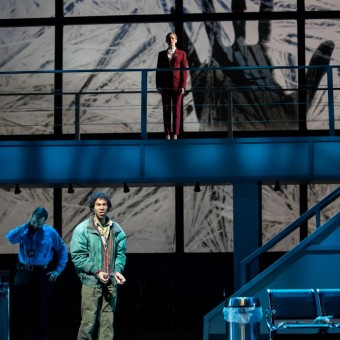 """Picture: Andrew Gilstrap as Immigration Officer, Cortez Mitchell as Refugee, and Katrina Galka as the Controller in Minnesota Opera's staging of """"Flight."""" Photo: Dan Norman."""