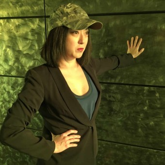 Katie Bradley as Wang Min in Full Circle Theater's Caught