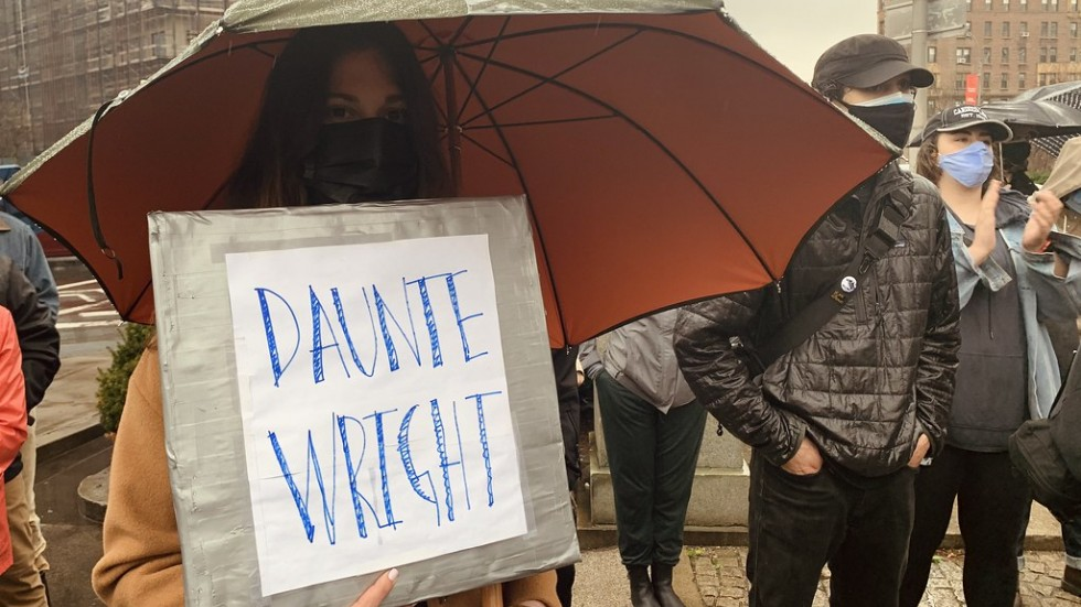 protester holding Daunte Wright sign