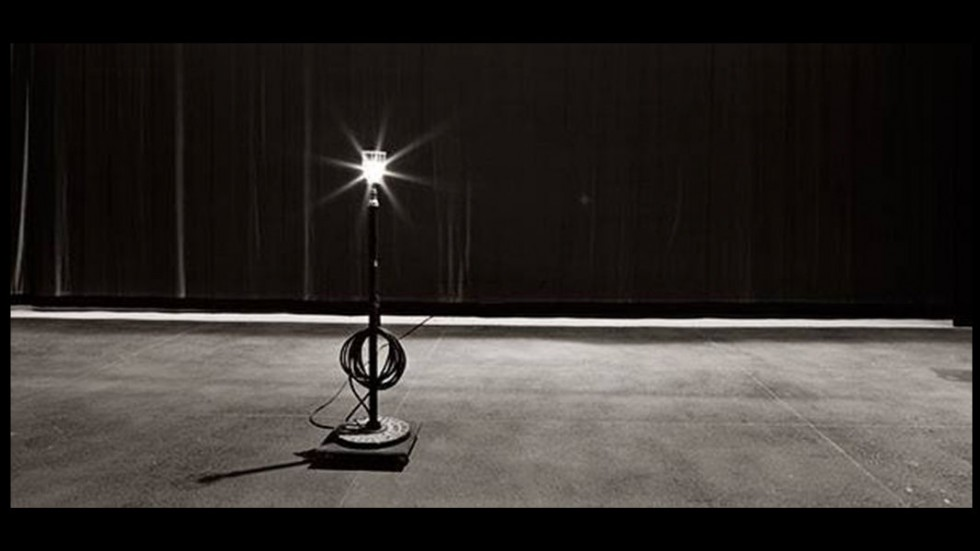 ghost light on a blank stage