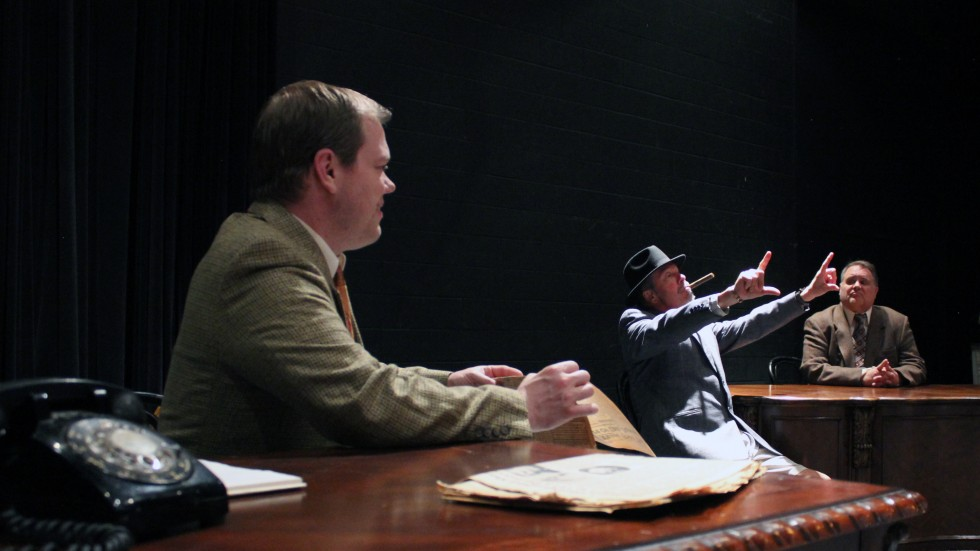 "Right to left: Archie Goodwin (Andrew Robertson) Inspector Cramer (Kevin Christensen) and Nero Wolfe (Scott Peterson) in ""The Red Box."""