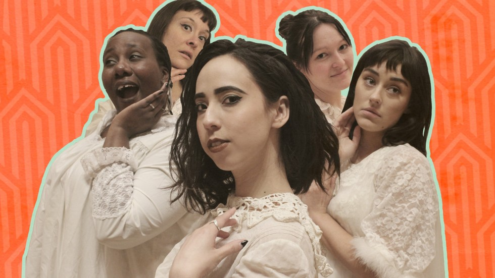 5 women in nightgowns pose against an orange background